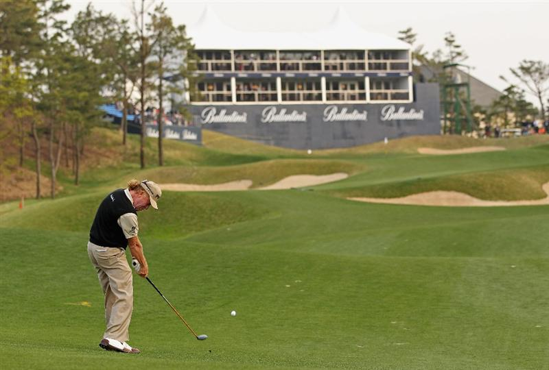 ICHEON, SOUTH KOREA - APRIL 29:  Miguel Angel Jimenez of Spain plays his second shot on the 18th hole during the second round of the Ballantine's Championship at Blackstone Golf Club on April 29, 2011 in Icheon, South Korea.  (Photo by Andrew Redington/Getty Images)