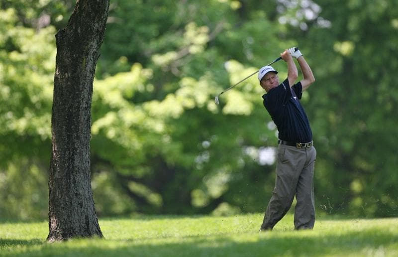BEACHWOOD, OH - MAY 23: Jeff Sluman hits his second shot on the 4th hole during the third round of the 70th Senior PGA Championship at Canterbury Golf Club on May 23, 2009 in Beachwood, Ohio. (Photo by Hunter Martin/Getty Images)