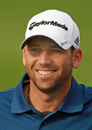BAHRAIN, BAHRAIN - JANUARY 26:  Sergio Garcia of Spain smiles during the Pro Am prior to the start of the Volvo Golf Champions at The Royal Golf Club on January 26, 2011 in Bahrain, Bahrain.  (Photo by Andrew Redington/Getty Images)