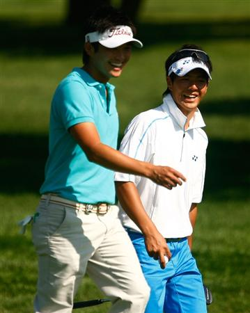 CHASKA, MN - AUGUST 10:  Ryuji Imada (L) and Ryo Ishikawa of Japan walk down a fairway during a practice round prior to the start of the 91st PGA Championship at the Hazeltine Golf Club on August 10, 2009 in Chaska, Minnesota.  (Photo by Scott Halleran/Getty Images)