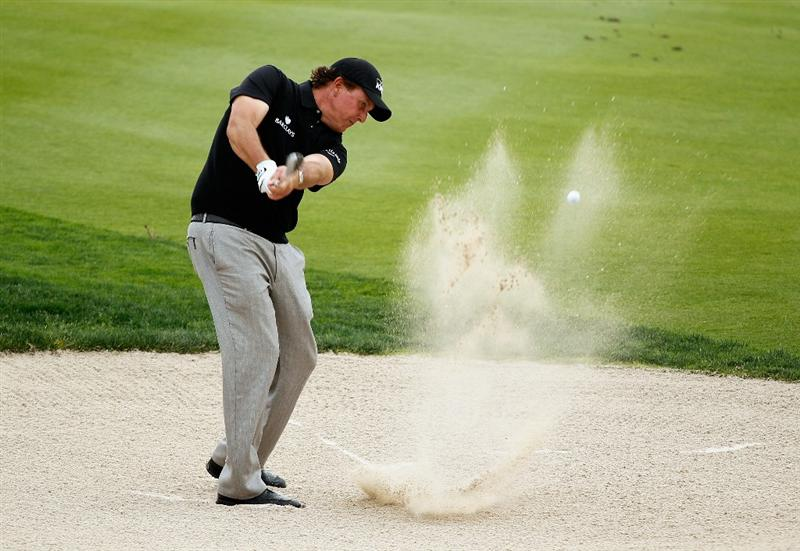 ABU DHABI, UNITED ARAB EMIRATES - JANUARY 18:  Phil Mickelson of the USA a bunker shot during a practice round prior to the start of the 2011 Abu Dhabi HSBC Golf Championship  at the Abu Dhabi Golf Club on January 18, 2011 in Abu Dhabi, United Arab Emirates.  (Photo by Scott Halleran/Getty Images)