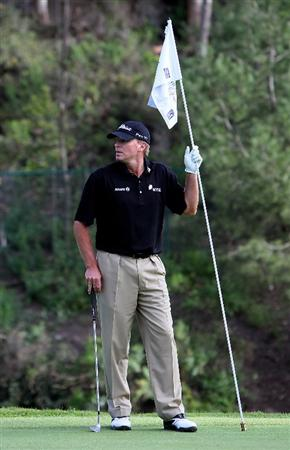 PACIFIC PALISADES, CA - FEBRUARY 04:  Steve Stricker holds the flag stick before putting on the 13th hole during the first round of the Northern Trust Open at Riviera Country Club on February 4, 2010 in Pacific Palisades, California.  (Photo by Jeff Gross/Getty Images)