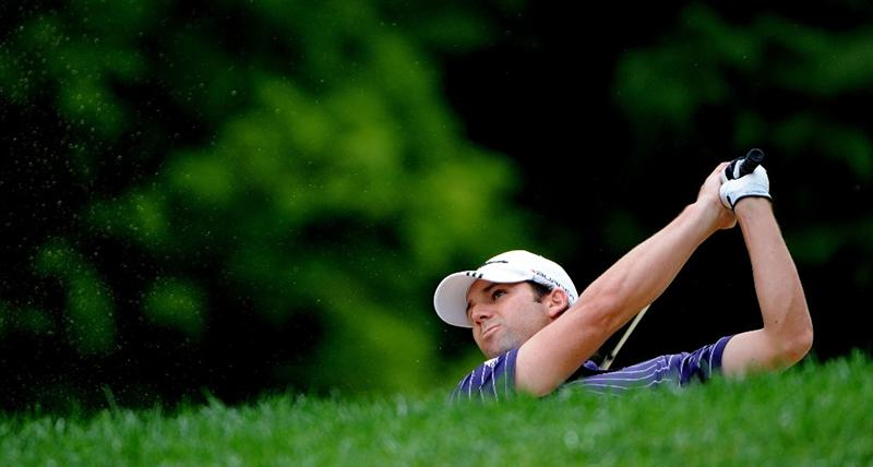 ST. LOUIS - SEPTEMBER 5:  Sergio Garcia hits out of the fairway bunker  during the rain delayed first  round of the BMW Championship held at Bellerive Country Club on September 5, 2008 in St. Louis, Missouri.  (Photo by Marc Feldman/Getty Images)