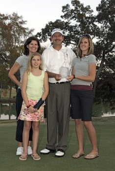Bart Bryant holding his championship trophy with his family after winning THE TOUR Championship at East Lake Golf Club in Atlanta, Georgia on November 6, 2005.Photo by Sam Greenwood/WireImage.com