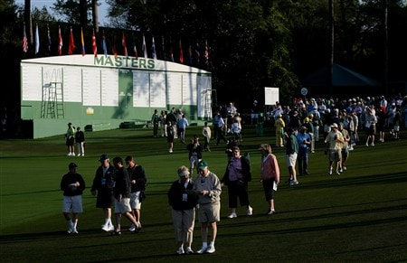 AUGUSTA, GA - APRIL 09:  Patrons walk by the main scoreboard during the third day of practice prior to the start of the 2008 Masters Tournament at Augusta National Golf Club on April 9, 2008 in Augusta, Georgia.  (Photo by Harry How/Getty Images)