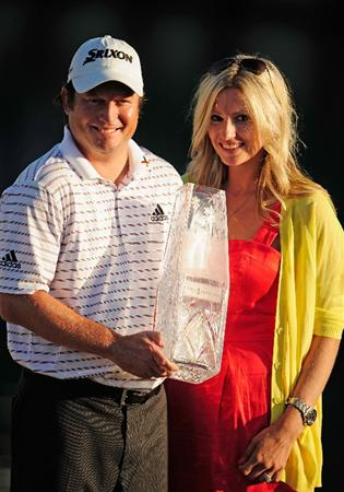 PONTE VEDRA BEACH, FL - MAY 09:  Tim Clark of South Africa poses with his wife Candace and the trophy after winning THE PLAYERS Championship held at THE PLAYERS Stadium course at TPC Sawgrass on May 9, 2010 in Ponte Vedra Beach, Florida.  (Photo by Richard Heathcote/Getty Images)