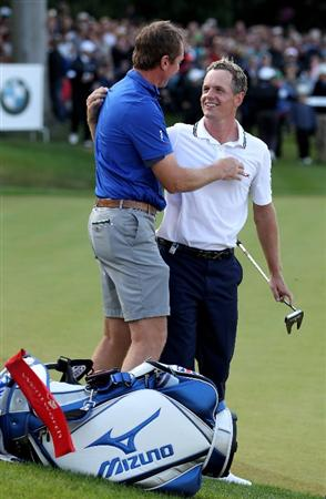 VIRGINIA WATER, ENGLAND - MAY 29:  Luke Donald of England is congratulated by his caddy John McLaren after victory in the playoff during the final round of the BMW PGA Championship  at the Wentworth Club on May 29, 2011 in Virginia Water, England.  (Photo by Richard Heathcote/Getty Images)