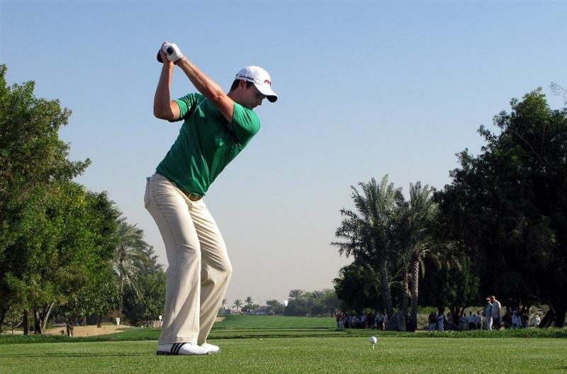 DUBAI, UNITED ARAB EMIRATES - JANUARY 31:  Justin Rose of England tees off on the third hole during the third round of the Dubai Desert Classic on the Majilis course at Emirates Golf Club on January 31, 2009 in Dubai, United Arab Emirates.  (Photo by Andrew Redington/Getty Images)