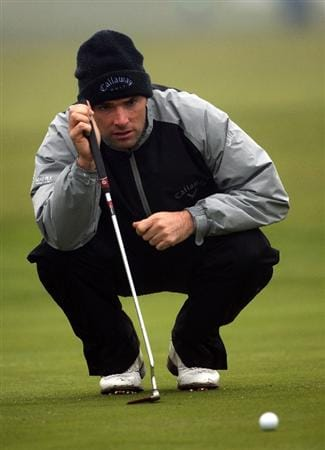 BALTRAY, IRELAND - MAY 15:  Oliver Wilson of England lines up a putt on the ninth hole during the second round of The 3 Irish Open at County Louth Golf Club on May 15, 2009 in Baltray, Ireland.  (Photo by Andrew Redington/Getty Images)