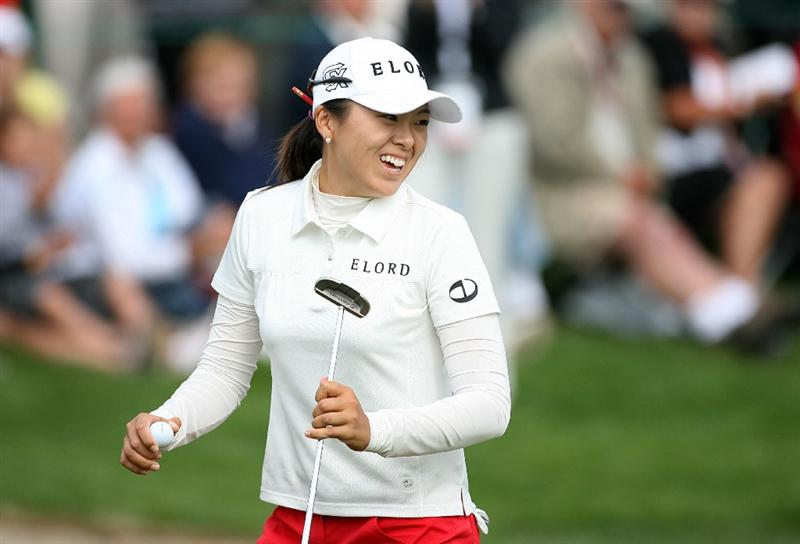 CALGARY, AB - SEPTEMBER 05 : M.J. Hur of South Korea reacts after making birdie on the 18th hole during the third round of the Canadian Women's Open at Priddis Greens Golf & Country Club on September 5, 2009 in Calgary, Alberta, Canada. (Photo by Hunter Martin/Getty Images)