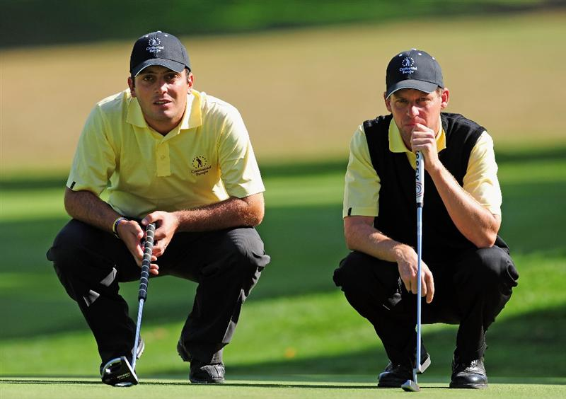 PARIS - SEPTEMBER 25:  Francesco Molinari and Anders Hansen of the Continental Europe team ponder their putts during the second day fourball at The Vivendi Trophy with Severiano Ballesteros at Saint - Nom - La Breteche golf course on September 25, 2009 in Paris, France.  (Photo by Stuart Franklin/Getty Images)