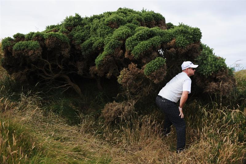 TURNBERRY, SCOTLAND - JULY 16:  Rory Sabbatini of South Africa looks for his ball on the 5th hole during round one of the 138th Open Championship on the Ailsa Course, Turnberry Golf Club on July 16, 2009 in Turnberry, Scotland.  (Photo by Harry How/Getty Images)