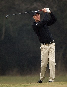 DELHI, INDIA - FEBRUARY 07:  Mads Vibe-Hastrup of Denmark hits his second shot at the 18th hole during the first round of the Emaar-MGF Indian Masters at the Delhi Golf Club, on February 7, 2008 in Delhi, India.  (Photo by David Cannon/Getty Images)