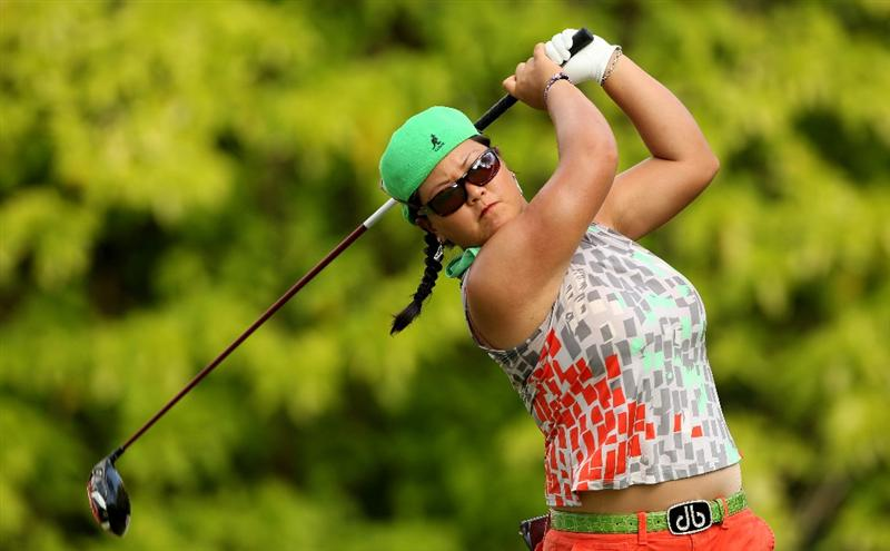 SINGAPORE - FEBRUARY 25:  Christina Kim of the USA hits her tee-shot on the sixth hole during the first round of the HSBC Women's Champions at the Tanah Merah Country Club on February 25, 2010 in Singapore.  (Photo by Andrew Redington/Getty Images)