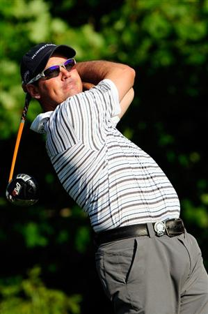 CHASKA, MN - AUGUST 13:  Rich Beem watches his tee shot on the tenth hole during the first round of the 91st PGA Championship at Hazeltine National Golf Club on August 13, 2009 in Chaska, Minnesota.  (Photo by Sam Greenwood/Getty Images)