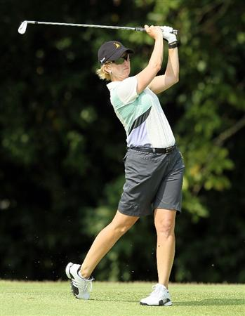 SINGAPORE - FEBRUARY 27:  Karrie Webb of Australia hits her second shot on the 4th hole during the third round of the HSBC Women's Champions at Tanah Merah Country Club on February 27, 2010 in Singapore, Singapore.  (Photo by Andy Lyons/Getty Images)