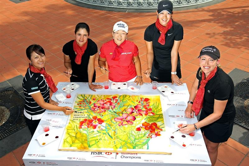 SINGAPORE - FEBRUARY 23:  (L-R ) Ai Miyazato of Japan, Lorena Ochoa of Mexico, Jiyai Shin of South Korea, Michelle Wie of the USA and Christie Kerr of the USA pose next to the batik artwork they all contributed to during a photocall at Raffles Hotel prior to the HSBC Women's Champions at the Tanah Merah Country Club  on February 23, 2010 in Singapore.  (Photo by Andrew Redington/Getty Images)