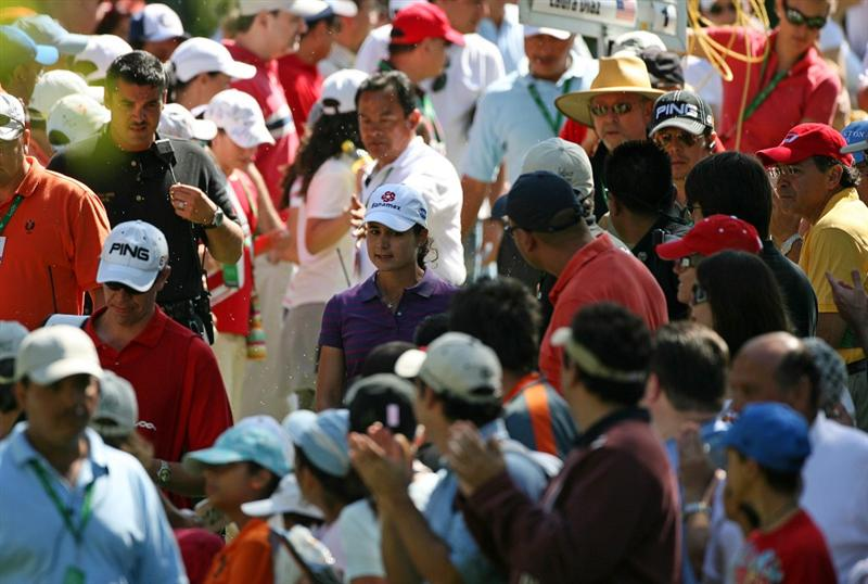 GUADALAJARA, MEXICO - NOVEMBER 16: Lorena Ochoa walks through the crowd to the 4th hole during the final round of the Lorena Ochoa Invitational at Guadalajara Country Club on November 16, 2008 in Guadalajara, Mexico. (Photo by Hunter Martin/Getty Images)