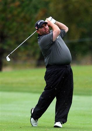 VERONA, NY - OCTOBER 01: Kevin Stadler hits his second shot on the 17th hole during the first round of the 2009 Turning Stone Resort Championship at Atunyote Golf Club held on October 1, 2009 in Verona, New York.  (Photo by Chris Trotman/Getty Images)