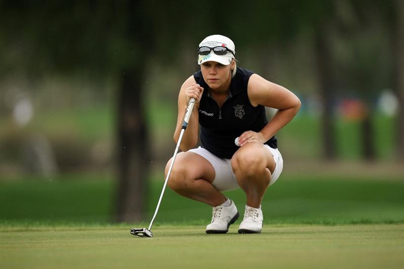 DUBAI, UNITED ARAB EMIRATES - DECEMBER 11:  Minea Blomqvist of Finland lines up a putt at the 10th hole during the third round of the Dubai Ladies Masters, on the Majilis Course at the Emirates Golf Club on December 11, 2009 in Dubai, United Arab Emirates.  (Photo by David Cannon/Getty Images)