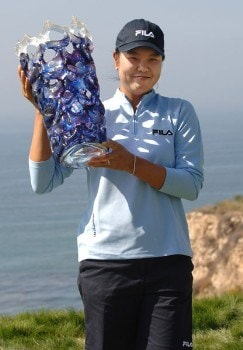 Hee-Won Han holds the winner's trophy on the 18th green after the continuation of the final round of the 2005 Office Depot Championship at Trump National Golf Club Los Angeles in Rancho Palos Verdes, California, September 3, 2005Photo by Steve Grayson/WireImage.com