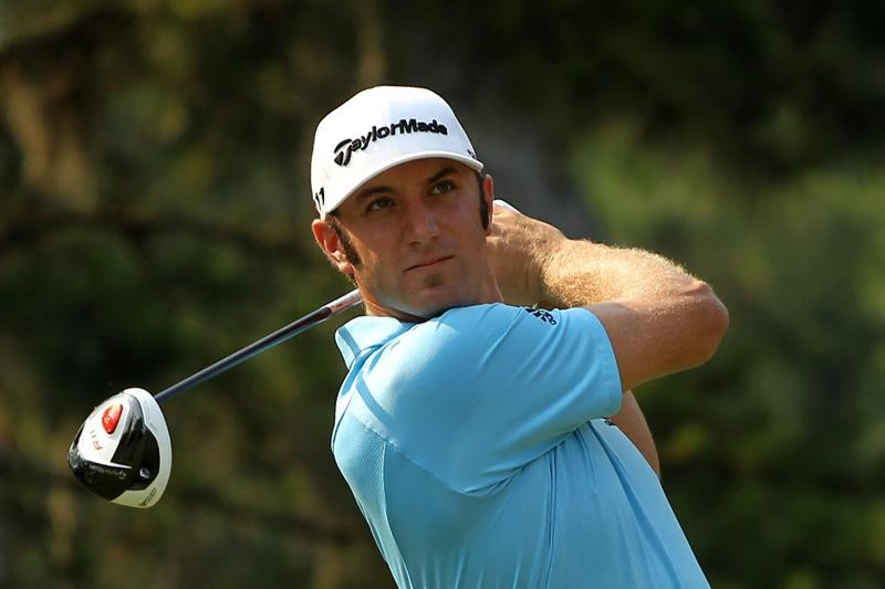 PONTE VEDRA BEACH, FL - MAY 10:  Dustin Johnson hits a shot during a practice round prior to the start of THE PLAYERS Championship held at THE PLAYERS Stadium course at TPC Sawgrass on May 10, 2011 in Ponte Vedra Beach, Florida.  (Photo by Scott Halleran/Getty Images)