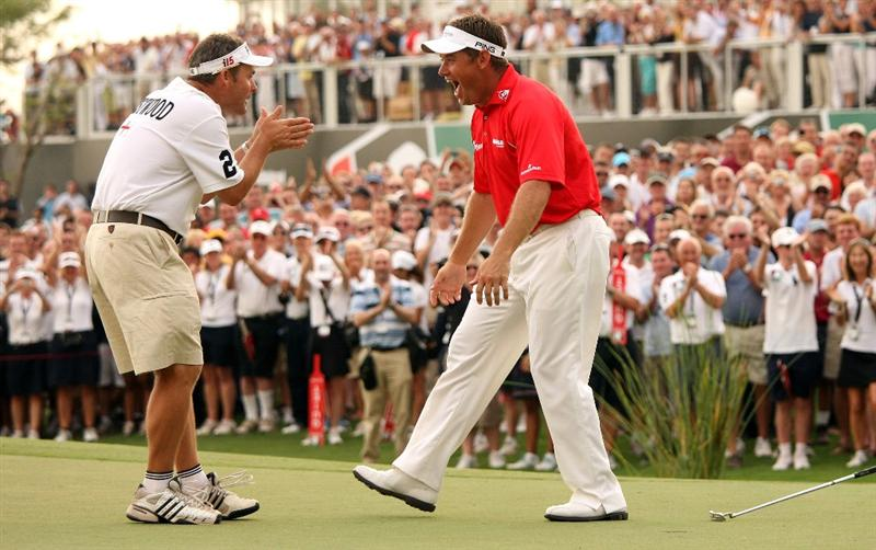 DUBAI, UNITED ARAB EMIRATES - NOVEMBER 22:  Lee Westwood of England celebrates with his caddie Billy Foster on the 18th hole after winning the Dubai World Championship and the Race To Dubai on the Earth Course, Jumeirah Golf Estates on November 22, 2009 in Dubai, United Arab Emirates.  (Photo by Andrew Redington/Getty Images)