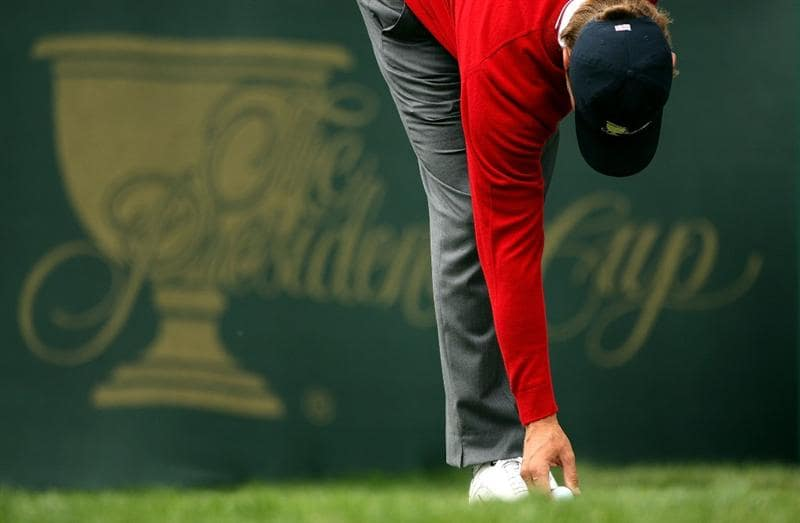 SAN FRANCISCO - OCTOBER 08:  Lucas Glover of the USA Team tees up his golf ball on the first hole during the Day One Foursome Matches of The Presidents Cup at Harding Park Golf Course on October 8, 2009 in San Francisco, California.  (Photo by Warren Little/Getty Images)
