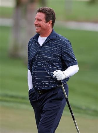 PALM BEACH GARDENS, FL - MARCH 03:  Hall-of-Fame NFL quarterback Dan Marino of the Miami Dolphins smiles toward his playing partners after making a long par putt on the first hole during the Honda Classic Kenny G Gold Pro-Am at PGA National Resort And Spa on March 3, 2010 in Palm Beach Gardens, Florida.  (Photo by Doug Benc/Getty Images)
