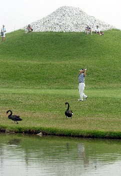 Eddie Lee from New Zealand plays his approach shot on the 18th to finish Rd3Photo by Jeff Crow/WireImage.com