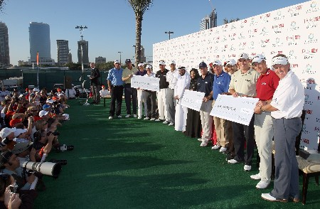 DUBAI, UNITED ARAB EMIRATES - JANUARY 29:  The players line up with the charity cheques after the Dubai Desert Classic Challenge Match, held on the par 3, course at the Emirates Golf Club, on January 29, 2007 in Dubai, United Arab Emirates.  (Photo by David Cannon/Getty Images)
