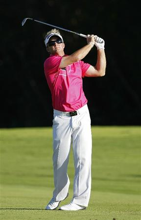 PLAYA DEL CARMEN, MEXICO - FEBRUARY 24:  Brian Gay hits a shot from the fairway during the first round of the Mayakoba Golf Classic at Riviera Maya-Cancun held at El Camaleon Golf Club on February 24, 2011 in Playa del Carmen, Mexico.  (Photo by Michael Cohen/Getty Images)