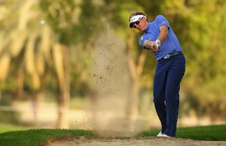 DUBAI, UNITED ARAB EMIRATES - JANUARY 31: Ian Poulter of England hits his second shot on the 18th hole during the first round of the Dubai Desert Classic on the Majilis course at Emirates Golf Club on January 31, 2008 in Dubai, United Arab Emirates. (Photo by Andrew Redington/Getty Images)