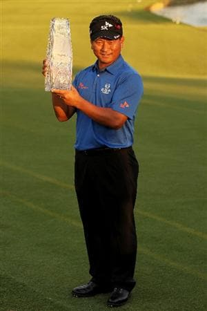 PONTE VEDRA BEACH, FL - MAY 15:  K.J. Choi of South Korea celebrates with the trophy after defeating David Toms on the first playoff hole during the final round of THE PLAYERS Championship held at THE PLAYERS Stadium course at TPC Sawgrass on May 15, 2011 in Ponte Vedra Beach, Florida.  (Photo by Mike Ehrmann/Getty Images)
