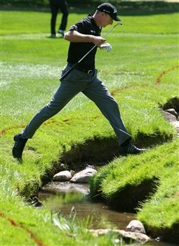 BLOOMFIELD HILLS, MI - AUGUST 07: Jim Furyk jumps over a stream while playing the fifth hole during round one of the 90th PGA Championship at Oakland Hills Country Club on August 7, 2008 in Bloomfield Township, Michigan.  (Photo by Stuart Franklin/Getty Images)