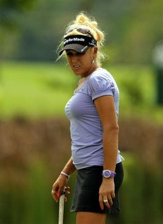 KUALA LUMPUR, MALAYSIA - OCTOBER 21:  Natalie Gulbis of USA watches her putting shot on the 9th hole during the Sime Darby Pro-Am at the KLGCC Golf Course on October 21, 2010 in Kuala Lumpur, Malaysia.  (Photo by Stanley Chou/Getty Images)
