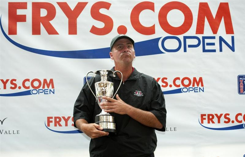 SAN MARTIN, CA - OCTOBER 17:  Rocco Mediate poses with the trophy after winning the Frys.com Open at the CordeValle Golf Club on October 17, 2010 in San Martin, California.  (Photo by Robert Laberge/Getty Images)