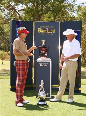 PERTH, AUSTRALIA - FEBRUARY 17:  (L-R) Ian Poulter of England and Greg Norman of Australia pose for photographers during the Pro-Celebrity event in aid of the Victorian Bushfires Red Cross appeal as a preview for the 2009 Johnnie Walker Classic tournament at the Vines Resort and Country Club on February 17, 2009 in Perth, Western Australia.  (Photo by Ian Walton/Getty Images)