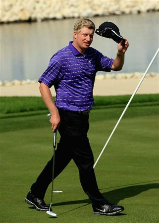 BAHRAIN, BAHRAIN - JANUARY 30:  Richard Finch of England waves to the crowd on the 18th green after shooting 63 during the final round of the Volvo Golf Champions at The Royal Golf Club on January 30, 2011 in Bahrain, Bahrain.  (Photo by Andrew Redington/Getty Images)