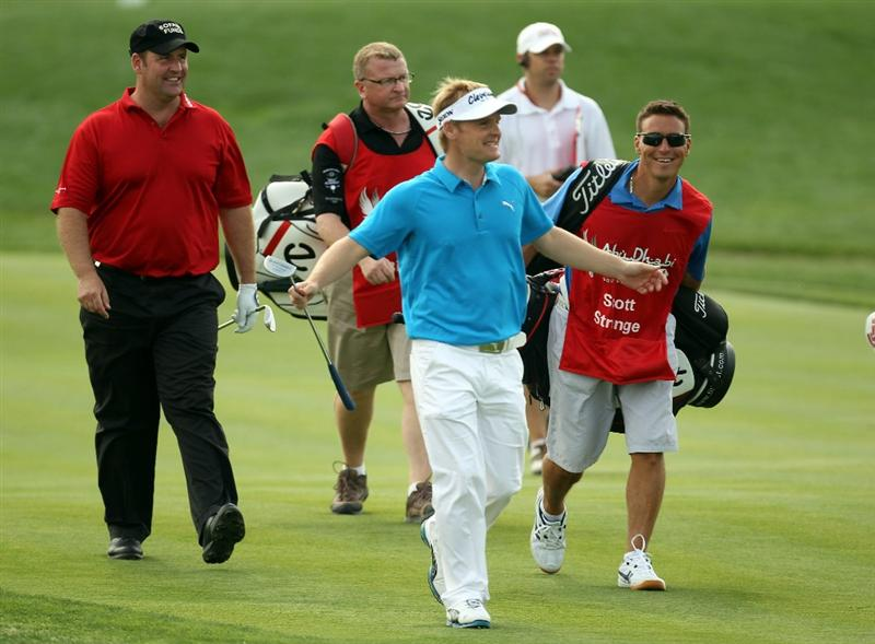 ABU DHABI, UNITED ARAB EMIRATES - JANUARY 20:  Soren Kjeldsen of Denmark celebrates after his hole in one on the par three 7th hole during the first round of the Abu Dhabi HSBC Golf Championship at the Abu Dhabi Golf Club on January 20, 2011 in Abu Dhabi, United Arab Emirates.  (Photo by Ross Kinnaird/Getty Images)