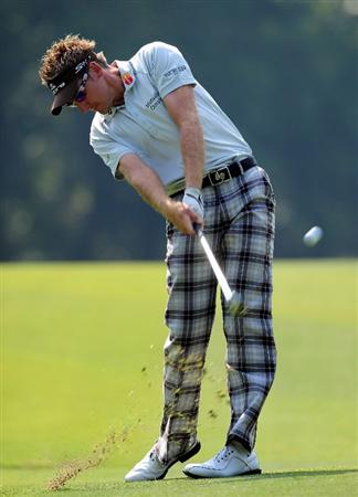 SHENZHEN, GUANGDONG - NOVEMBER 25:  Ian Poulter of England plays a shot during pro - am the Omega Mission Hills World Cup on the Olazabal course on November 25, 2009 in Shenzhen, China.  (Photo by Stuart Franklin/Getty Images)
