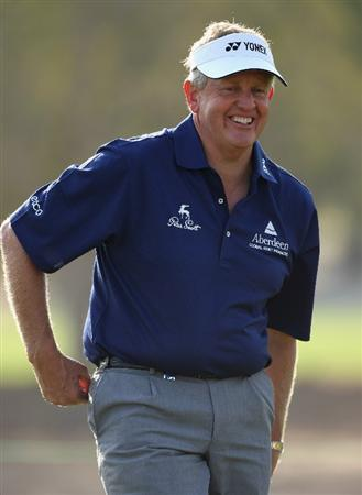 DOHA, QATAR - JANUARY 21:  Colin Montgomerie of Scotland smiles on the fifth hole during the Pro Am for the Commercialbank Qatar Masters at Doha Golf Club on January 21, 2009 in Doha, Qatar.  (Photo by Andrew Redington/Getty Images)