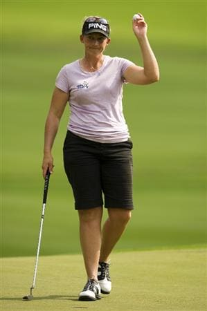 CHON BURI, THAILAND - FEBRUARY 20:  Angela Stanford of USA acknowledges the crowd on the 17th green during round three of the Honda PTT LPGA Thailand at Siam Country Club on February 20, 2010 in Chon Buri, Thailand.  (Photo by Victor Fraile/Getty Images)
