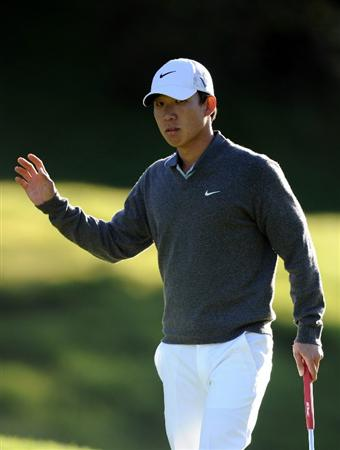 PACIFIC PALISADES, CA - FEBRUARY 17:  Anthony Kim reacts to a birdie putt on the seventh hole during the first round of the Northern Trust Open at the Riviera Country Club on February 17, 2011 in Pacific Palisades, California.  (Photo by Harry How/Getty Images)