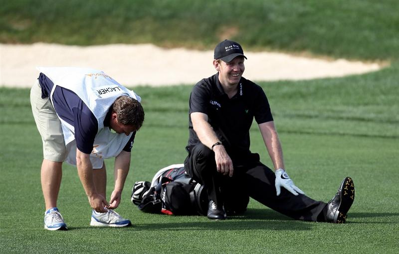SEVILLE, SPAIN - APRIL 30: Stephen Gallacher of Scotland and his caddie during the second round of the Open de Espana at the Real Club de Golf de Seville on April 30, 2010 in Seville, Spain.  (Photo by Ross Kinnaird/Getty Images)