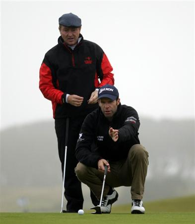 KINGSBARNS, SCOTLAND - OCTOBER 08:  Michael Flatley, creator of Lord of the Dance, (left) is given some dvice by his playing partner Bradley Dredge of Wales during the second round of The Alfred Dunhill Links Championship at Kingsbarns Golf Links on October 8, 2010 in Kingsbarns, Scotland.  (Photo by Andrew Redington/Getty Images)