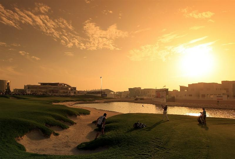 BAHRAIN, BAHRAIN - JANUARY 29: James Kingston of South Africa plays his second shot at the 18th hole during the third round of the 2011 Volvo Champions held at the Royal Golf Club on January 29, 2011 in Bahrain, Bahrain.  (Photo by David Cannon/Getty Images)