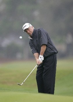 Curtis Strange competes in the rain delayed first round of the Champions Tour Outback Steakhouse Pro-Am at the TPC at Tampa Bay in Lutz, FL