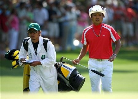 AUGUSTA, GA - APRIL 11:  Shingo Katayama of Japan walks with his caddie Masaki Tani during the second round of the 2008 Masters Tournament at Augusta National Golf Club on April 11, 2008 in Augusta, Georgia.  (Photo by Andrew Redington/Getty Images)