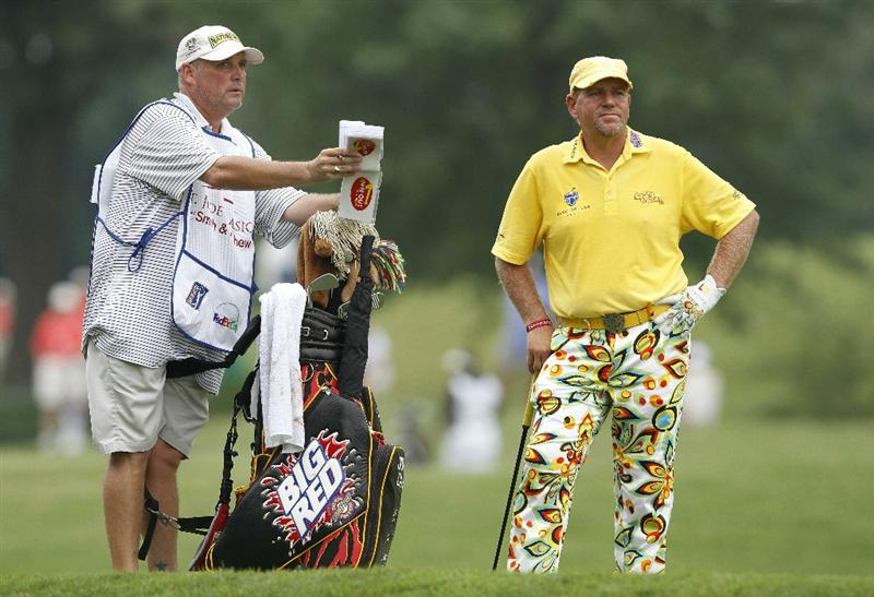 MEMPHIS, TN - JUNE 11: John Daly waits for his second shot in the 9th fairway during the second round of the St. Jude Classic at TPC Southwind held on June 11, 2010 in Memphis, Tennessee.  (Photo by John Sommers II/Getty Images)